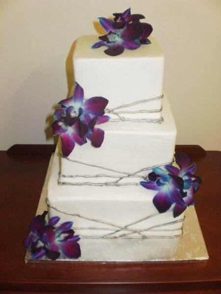Purple Square Wedding Cake Pillars And Flowers Silver White Indoor Ceremony Reception