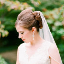 130x130 sq 1418942838105 veil wedding hairstyles sophisticated updo