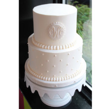 220x220 sq 1404405596693 swiss monogram wedding cake main