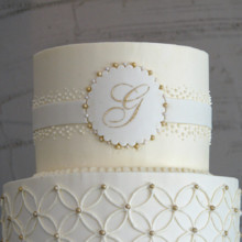 220x220 sq 1404405633460 overlapping circles wedding cake 3