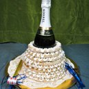 130x130 sq 1267682697660 bottleofchampagne2