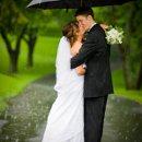 130x130 sq 1288885433791 raincouple