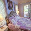 130x130_sq_1262508227856-purplebedroom