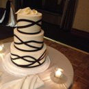 Amazing wedding cake by Bittersweet Pastry Shop at The Metropolitan Club in the East Room