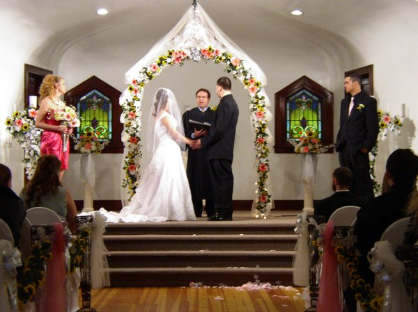 indoor wedding arches. royal view hall ~ wedding arch in pink and sunflowers indoor arches
