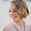 Statement necklace made with Swarovski pearls, crystals and chains. Birdcage veil with scattered Swarovski crystals.