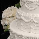 130x130_sq_1263986473386-traditionalwhiteweddingcake