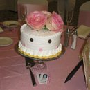 130x130 sq 1264118902718 cakecenterpierce