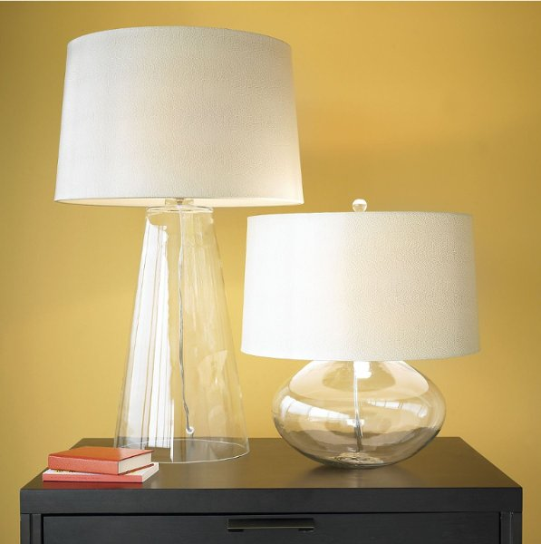 <b>Jack Table Lamp</b><br>A cotton lined, snakeskin-embossed faux leather shade overscales an ovaline clear glass base to create bold proportions