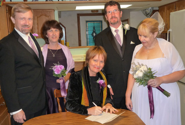 1393359550214 Signing Licens St Paul wedding officiant