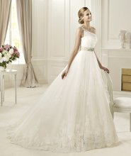 DIOSA The Diosa model from the Pronovias 2013 collection has a modern feel that comes from an original asymmetric bodice that hides an inner neckline. A single strap is decorated with silver embroidery that matches the spectacular brooch at the waist. A softly draped bodice hugs the body and a wide tulle skirt create a wonderful princess wedding dress. The skirt gives volume to the dress with its tulle layers and scallops of lace around the hem.