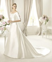UBALDI This wedding dress is made of soft mikado silk. Ubaldi, an A-line wedding dress from the Costura by Pronovias 2013 collection, owes its elegance to a beautiful scoop neckline. Elbow-length sleeves, open at the sides, are decorated with original soutage and beading. The elegant skirt embellishes the flattering silhouette and accentuates the delicacy of the model.