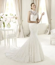 UGALDE The romantic style of Ugalde from the Costura of the Pronovias 2013 collection is enhanced by a sleeveless funnel-neck jacket. This elegant mermaid wedding dress in rebrodé lace has a delicate appearance. It features a stunning sweetheart neckline decorated with original cut-out appliqués. A wide skirt with elegant scallops around the hem accentuates its flattering, feminine style.