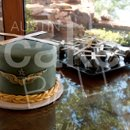 A helicopter grooms cake with an Army uniform braid complimented with a fleet of custom helicopter cake balls for a blackhawk pilot.