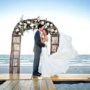 130x130 sq 1418497507200 bride and groom married on the beach