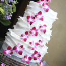 130x130 sq 1426955535423 camisa wedding cake with purple orchids