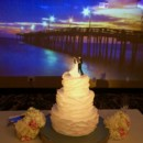 130x130 sq 1433004136959 cake with pier at sunset background