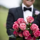 130x130 sq 1272295505503 weddingphotogallerypic20nolanholdingbouquetofpinkrosesintuscanywedding