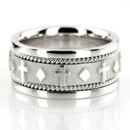 A gorgeous Christian design! This 8.5mm wide Religious wedding ring has beautifully carved crosses evenly spaced all around the center. The handmade design is complete with two small braids on each side and shiny edges. This wedding band is also available in 9.5, 10.5, 11.5, and Two Color Gold. Center of the band is high polished, with a matte background. Small braids and each side are also high polished.