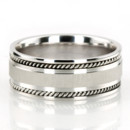 Thanks to its sturdy design and 8.5mm width, this Hand crafted wedding ring is a favorite Men's jewelry. Center of the band is brush finished, small braids and each side are high polished.