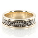 A gorgeous contemporary style, this 6mm wide Hand crafted wedding ring has four shiny rows of White Gold braids, and Yellow gold edges. Small braids in the center of the band are White Gold high polished. Each side are Yellow gold high polished.