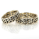An exquisite Celtic design, this 6mm wide Handcrafted wedding band set has a traditional Celt motif with several holes. The band is high polished all around.
