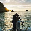 130x130 sq 1268193559610 weddingsyoungsunset