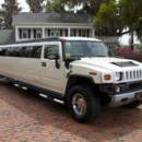130x130_sq_1399914561295-0---white-stretch-hummer-h2-limousine---fleet-page