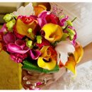 130x130 sq 1326905206171 tropicalflowersbouquet
