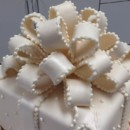 130x130 sq 1465568083703 fancy ivory bow upclose