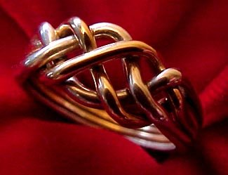 photo 1 of Puzzle Rings by Norman Greene