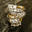 Three stone diamond engagement rings in 14k yellow and white gold and platinum.