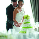 130x130 sq 1371659953253 bride and groom cutting cake