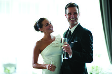 220x220 1404141084251 bride and groom smiling during toast