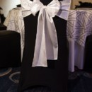 130x130 sq 1369325168559 chaircoveroptionblackwhitebow