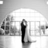 96x96 sq 1395420442349 bride and groom in the front lobby drew newma