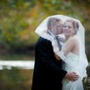 130x130 sq 1416668192670 bride and groom kiss under veil