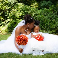 220x220 sq 1416669386362 bride sitting in grass with flowergirl