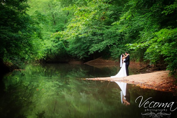 600x600 1416667721454 bride and groom embrace on river