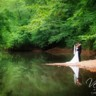 96x96 sq 1416667721454 bride and groom embrace on river