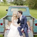 130x130 sq 1430923917772 bride and groom in back of truck