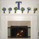 130x130 sq 1430409255420 bouquets on mantle wfire on