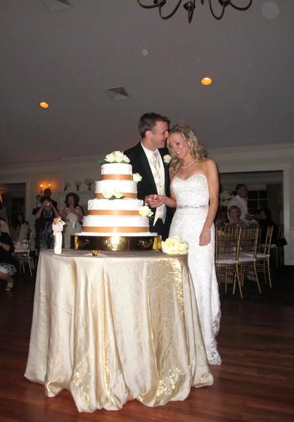 600x600 1430409398865 cutting cake kelly and steve