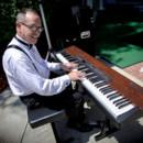 130x130 sq 1425583899752 piano player no watermarkjpg