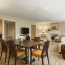 130x130 sq 1370890469602 suite parlor w table 0000788248