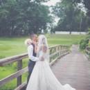 130x130 sq 1447513432762 bride and groom on bridge