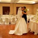 130x130 sq 1374681900170 bride  groom kissing
