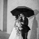 130x130 sq 1485968331040 bride and groom under umbrella black white pic