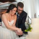 130x130 sq 1485968379267 couple cutting cake