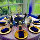 130x130 sq 1431793146444 reception tables with vibrant blue decor
